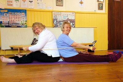 TWO WAY STRETCH! Pilates regulars Imelda Walker, left, and Vivienne Bale do a two-way stretch with a giant rubber band during their popular weekly class at Southwick.